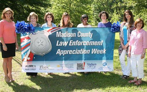Women holding Law Enforcement Week banner